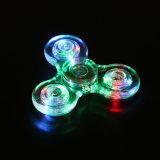 투명한 싱숭생숭함 방적공 EDC 손 방적공 플라스틱 LED 가벼운 세 배 방적공 싱숭생숭함은 수정같은 감압 방적공을