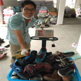 Используемые люди способа холстины обувают 2015 от Китая