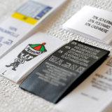 A tela quente da venda imprimiu etiquetas da roupa