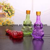 يعبر شراب زجاجيّة كمي شكل زجاجات