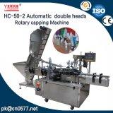 Machine recouvrante rotatoire de doubles chapeaux en plastique automatiques de têtes (HC-50-2)