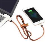 Relâmpago de couro que cobra o cabo de dados do carregador do USB para o iPhone