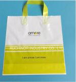 Bolso de compras suave plástico de la maneta del bucle del LDPE con el escudete lateral para las compras de la ropa