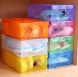 A caixa de sapata transparente plástica grossa calç a caixa de armazenamento