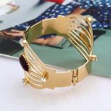 Braccialetti semplici del braccio della lega dell'argento Exaggerated dell'oro dei braccialetti dei braccialetti del polsino della cavità dei monili di Steampunk di modo