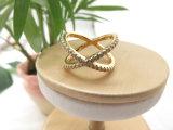女性のためのジルコンの石が付いている真鍮の銅の金Xの形のリング