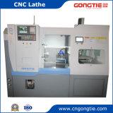 Torno CNC automática con el cargador de pórtico en la bandeja de elementos hidráulicos