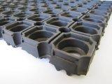 La gomma vuota riciclata esterna del pavimento del portello dell'anello fora le stuoie