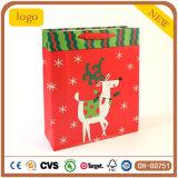 Sac de papier de cadeau rouge de renne de Noël