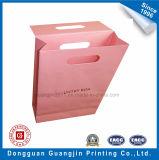 ピンク磁石が付いているカラーによって印刷されるクラフト紙のギフト包装袋