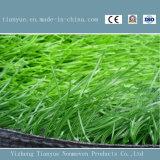 Ковер травы футбола нестандартной конструкции широко