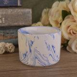 Sostenedores de vela de cerámica del mármol de la taza de Panit