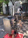 小さい縦の込み合いの蜂蜜およびのりの液体のパッキング機械