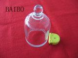 Campana de vidrio transparente con el botón Top