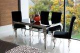 Tableau dinant moderne de meubles de salle à manger mis avec le dessus en verre