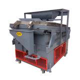 手持ち型のプラム石取り機