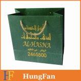 Bolso de compras de papel reutilizable verde con la insignia de Hotstamping del oro