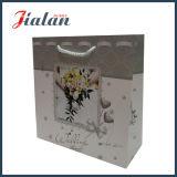 A laminação lustrosa vende por atacado o logotipo feito sob encomenda feito saco de empacotamento do presente de casamento