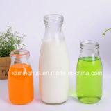 Frasco de leite de vidro transparente