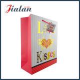 El día de fiesta del día del `S de la tarjeta del día de San Valentín modifica la bolsa de papel para requisitos particulares de sellado caliente impresa del oro