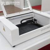 Máquina de estaca automática do laser para a idéia nova do negócio dos acessórios do telefone de pilha