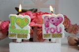 Suministro de parte del pastel en forma de corazón vela