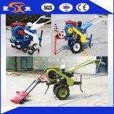 農場トラクターの小型耕うん機はとの/Discの芝刈り機を切る