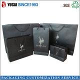 La ropa de papel negra de encargo del bolso de compras empaqueta al por mayor