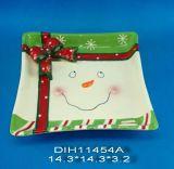 Plaque en céramique peinte à la main de bonhomme de neige dans le grand dos