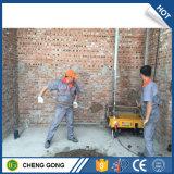 Cemento del macchinario di costruzione che intonaca l'automobile della macchina per la parete