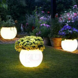 La luz macetas macetas de jardín iluminado por la noche resplandor de la sembradora