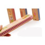 Hölzernes Loch-Kind-Musikinstrument-Geschenk-pädagogische Spielwaren der Harmonika-24