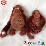 Le cadeau de Noël de gorille de Brown badine le jouet bourré mou mignon de peluche