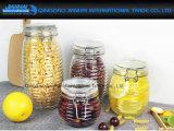 クリップ上が付いている通されたガラス蜂蜜の記憶の鍋の瓶