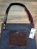 Avental feito sob encomenda do couro do artesão para o Mens com bolsos
