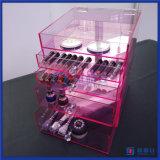 Organizador cosmético acrílico cor-de-rosa feito sob encomenda da composição com botões do diamante