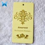 Tarjeta de papel de tarjetas brillante de la escritura de la etiqueta de la ropa de la insignia del oro de la marca de fábrica de la impresión