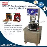 Halbautomatisches Vakuummit einer kappe bedeckende Maschine für in Büchsen konservierten Pfirsich (BZX-65)
