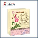 Modificar la bolsa de papel para requisitos particulares impresa las flores retras del regalo del portador que hace compras
