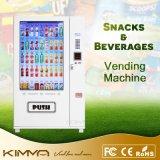 Paleta helada de fruta y máquina expendedora enfriada de la bebida con la pantalla táctil llena