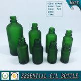 Frasco de vidro verde geado para o petróleo essencial dos cosméticos com tampão de alumínio