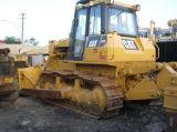 Utilisé des bulldozers
