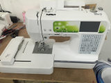 Máquina de costura e bordado computadorizada doméstica