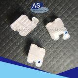 Parentesi di ceramica ortodontiche della base della maglia