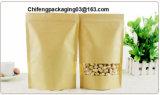 Il sacco di carta del mestiere naturale con la chiusura lampo & la stagnola naturale del mestiere si levano in piedi in su il sacchetto