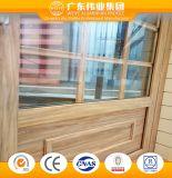 Portello scorrevole di alluminio di stile giapponese con la superficie di legno del grano