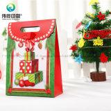O saco de papel de empacotamento o mais atrasado do presente da impressão da árvore de Natal do costume