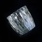 Frasco de vidro transparente da vela com teste padrão vertical da grão