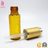 Envase de cristal ambarino del petróleo esencial con el casquillo de aluminio