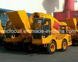 individu 3m3 chargeant le camion de mélange concret